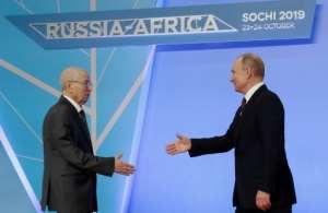 Russian President Vladimir Putin greets Algeria's President Abdelkader Bensalah at the first ever Russia-Africa summit in Sochi on October 23, 2019.  By Sergei CHIRIKOV (POOL/AFP)