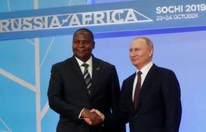 Russian President Vladimir Putin is seen here with Central African President Faustin Archangel Touadera; an investigation of a disinformation campaign on Facebook has linked the effort to Yevgeny Prigozhin, a key ally of the Russian leader.  By Sergei CHIRIKOV (POOL/AFP/File)