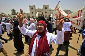 Scores of doctors in their white robes marched from Khartoum's main hospital towards the sit-in on Wednesday.  By ASHRAF SHAZLY (AFP)