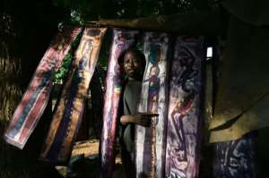 Sales of crafts like these batik print textiles have fallen as tourist numbers shrink.  By ISSOUF SANOGO (AFP)