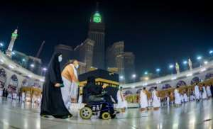 Saudis and foreign residents circumambulate the Kaaba in the Grand Mosque complex in the holy city of Mecca.  By - (Saudi Ministry of Hajj and Umra/AFP)
