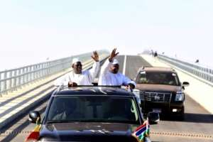 Senegal's president Macky Sall (L) and Gambian President Adama Barrow (R) wave as they inaugurate the Senegambia Bridge built to facilitate trade and travel in this part of West Africa.  By SEYLLOU (AFP)