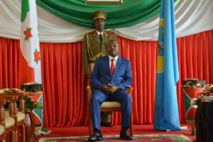 Seat of power: Nkurunziza, pictured at the presidency last June ahead of a meeting with the UN's special envoy to Burundi, Michel Kafondo..  By STR (AFP)