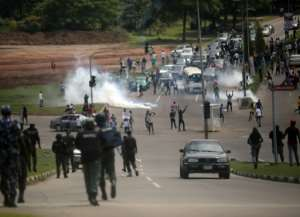 Security forces fire tear gas at protesters in Abuja.  By Kola Sulaimon (AFP)