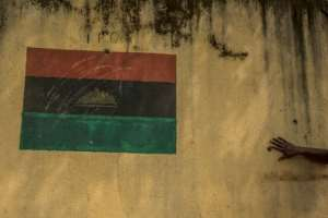 Separatism: A drawing of the Biafran flag on a wall in the pro-independence region of Umuahaia. By CRISTINA ALDEHUELA (AFP)