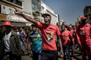 Several hundred opposition Movement for Democratic Change (MDC) supporters gathered outside the party headquarters in Harare, chanting and shouting that they had won the elections.  By Luis TATO (AFP)