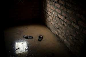Shoes float in what was once a living room of a house in Bangui.  By FLORENT VERGNES (AFP)