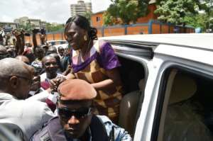 Simone Gbagbo arriving home in Abidjan on Wednesday following her amnesty.  By SIA KAMBOU (AFP/File)