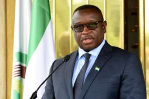 Sierra Leone president Julius Maada Bio, pictured in May 2018, marked his 100th day in office by hiking fuel prices, sparking protests in capital city Freetown.  By Sia KAMBOU (AFP/File)