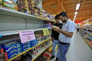 Signs were placed on shelves in Yemeni capital Sanaa calling on customers to boycott French goods.  By Mohammed HUWAIS (AFP)