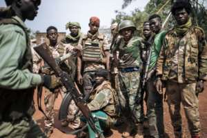 Six armed groups joined forces and launched an offensive, vowing to disrupt December's elections and march on the capital.  By ALEXIS HUGUET (AFP)