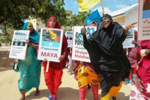 Somali women protested against Al-Shabaab in Mogadishu days after the massive car-bomb attack in the city.  By Abdirazak Hussein FARAH (AFP/File)