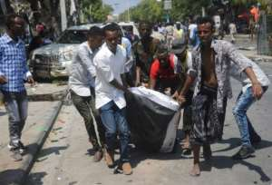 Somalis rushed in to help take the wounded to hospital after the bombing. By MOHAMED ABDIWAHAB (AFP)