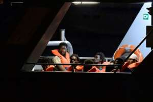 Some of the 65 migrants, rescued by the German-flagged NGO rescue ship Alan Kurdi are brought in to land by the Armed Forces of Malta.  By Matthew Mirabelli (AFP)