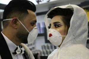Some people are making creative use of their masks, such as at this Palestinian wedding. By HAZEM BADER (AFP)