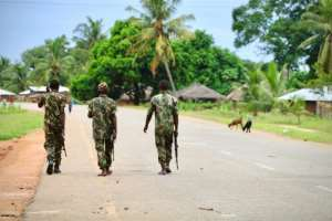 Soldiers from the Mozambican army (pictured March 2018) patrol the streets after security in the area was increased, following a two-day attack from suspected islamists in Mocimboa da Praia.  By ADRIEN BARBIER (AFP/File)