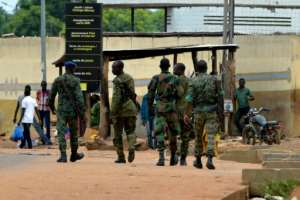 Soldiers, paramilitary gendarmes and police are on patrol to prevent any flare-up of violence.  By SIA KAMBOU (AFP)