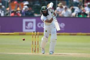 South Africa batsman Hashim Amla plays a shot on the first day of the first Test against Sri Lanka at the Port Elizabeth cricket ground in Port Elizabeth on December 26, 2016.  By GIANLUIGI GUERCIA (AFP/File)