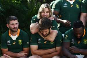 South Africa scrum-half Faf de Klerk (top) jokes with centre Frans Steyn.  By CHARLY TRIBALLEAU (AFP/File)