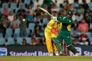 South African batsman Quinton de Kock (R) plays a shot