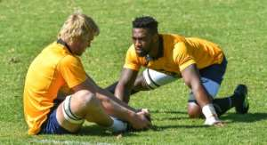 South African captain, Siya Kolisi (R), and flanker Pieter-Steph du Toit, seen during a Springboks training session at St Stithies College in Johannesburg, on May 28, 2018.  By Christiaan Kotze (AFP/File)