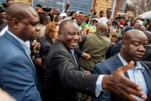 South African President Cyril Ramaphosa greeted voters before casting his ballot at a primary school in Soweto. By Michele Spatari (AFP)