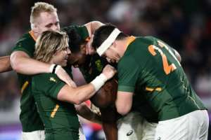 South Africa's Makazole Mapimpi (C) is congratulated by teammates after scoring a try during the Japan 2019 Rugby World Cup final against England.  By Anne-Christine POUJOULAT (AFP)