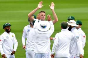 South Africa's Morne Morkel (C) celebrates with team mates after New Zealand's captain Kane Williamson was caught on day three of their 2nd Test match, at the Basin Reserve in Wellington, on March 18, 2017