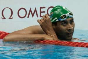 South Africa's Achmat Hassiem reacts after competing a heat of men's 100 m freestyle (S10) of the Rio 2016 Paralympic Games