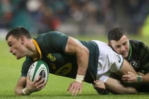 South Africa's centre Jesse Kriel (L) is tackled by Ireland's centre Robbie Henshaw during their rugby union Test match, at the Aviva Stadium in Dublin, on November 11, 2017