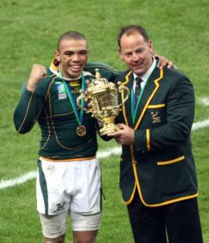 South Africa's coach Jake White wing Bryan Habana celebrate with the cup.  By FRANCK FIFE (AFP)