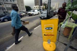 South Africa's telecom giant MTN has operations in different countries including Nigeria, where it was fined in 2015 for missing a deadline to disconnect unregistered SIM cards.  By PIUS UTOMI EKPEI (AFP/File)