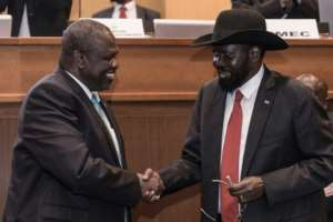 South Sudan's President Salva Kiir (R, pictured September 2018) and his former deputy turned rebel leader Riek Machar (L) last saw each other in October 2018, shortly after the signing of a power-sharing deal. By YONAS TADESSE (AFP/File)