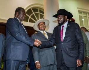 South Sudan's President Salva Kiir, right, shakes the hand of rebel leader Riek Machar in July.  By SUMY SADURNI (AFP/File)
