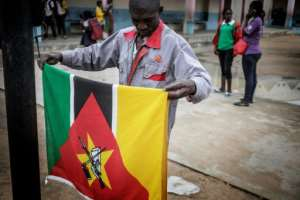 Soviet symbols in Africa include the Kalashnikov rifle featured on the flag of Mozambique.  By GIANLUIGI GUERCIA (AFP)
