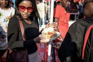 Soweto's iconic 'Kota' street sandwich inspired a festival in the township.  By GIANLUIGI GUERCIA (AFP)