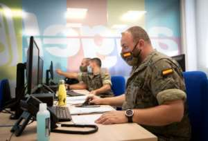 Spanish soldiers work at a coronavirus patient tracking centre in Palma de Mallorca.  By JAIME REINA (AFP)