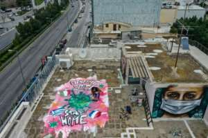 Spraypainted graffiti, inspired by the COVID-19 novel coronavirus, on the roof of the artist's apartment building in Athens.  By Aris Messinis (AFP)