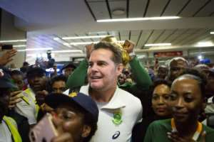 Springboks coach Rassie Erasmus (C) surrounded by Springbok supporters at OR Tambo airport near Johannesburg this week after arriving from Japan.  By Guillem Sartorio (AFP)