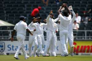 Sri Lanka celebrate the wicket of South Africa opening batsman Dean Elgar (not shown) during the third Test at Wanderers Cricket Stadium in Johannesburg on January 12, 2017