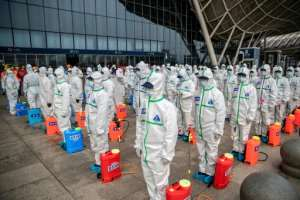 Staff prepare to spray disinfectant at Wuhan Railway Station.  By STR (AFP)