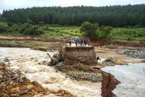 Stranded: Loggers on a damaged road on Charter Estate, Chimanimani. By Zinyange AUNTONY (AFP)