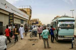 Stranded passengers wait at Khartoum's main bus terminal on May 28, 2019 as employees participate in a two-day national strike to step up pressure on the ruling military council.  By Ebrahim Hamid (AFP)