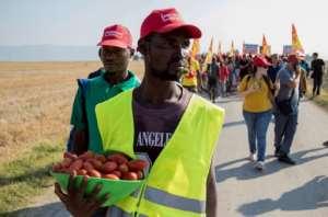 Striking demonstrators shouted