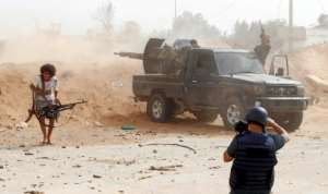 Strongman Khalifa Haftar's forces are fighting troops loyal to Libya's UN-recognised Government of National Accord for control of Tripoli.  By Mahmud TURKIA (AFP/File)