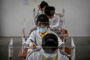 Students went back to school in Wuhan, China where the virus first emerged last year.  By STR (AFP)