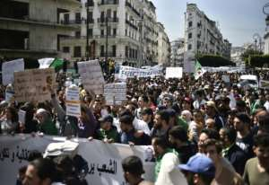 Students marching in the Algerian capital on April 2, 2019 say the announced departure of President Abdelaziz Bouteflika is a mere diversion. By RYAD KRAMDI (AFP)
