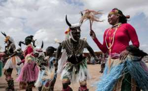 Sudan is a Muslim-majority nation but includes Christians and people following their own indigenous beliefs, including in the homeland of these dancers from the southern Nuba Mountains region, here photographed in August 2019.  By Jean Marc MOJON (AFP)