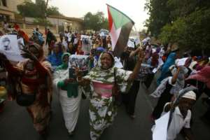 Sudanese women -- who played a key part in the protest movement - march through the streets of the capital in late May.  By ASHRAF SHAZLY (AFP/File)