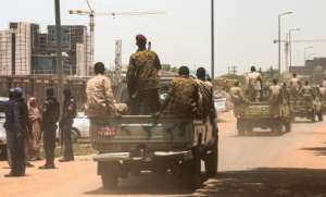 Sudanese army convoy escorts ex-president Omar al-Bashir (unseen) back to prison after his appearance in court in the capital Khartoum.  By Ebrahim HAMID (AFP)